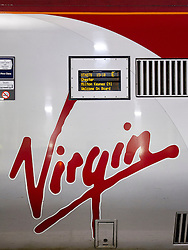 © Licensed to London News Pictures. 04/10/2012. LONDON, UK. The Virgin logo and destination board are seen on a Virgin train at Euston Station in London.  Photo credit: Matt Cetti-Roberts/LNP