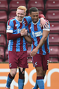Luke Williams of Scunthorpe United hugs Jordan Clarke of Scunthorpe United after he scored to 2-0 up during the Sky Bet League 1 match between Scunthorpe United and Swindon Town at Glanford Park, Scunthorpe, England on 28 March 2016. Photo by Ian Lyall.