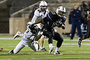Cedar Ridge runningback gains yardage against McNeil Thursday at Kelly Reeves Athletic Complex.  (LOURDES M SHOAF for Round Rock Leader)