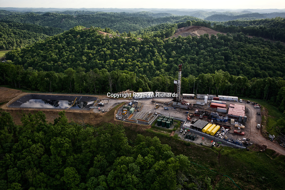Aerial view of a drilling rig and waste water pit used for fracking (hydraulic fracturing) operations on a mountain in Doddridge County, West Virginia.