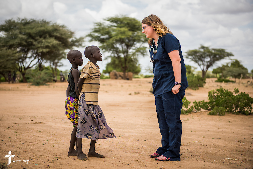 Sarah Kanoy, a career missionary in East Africa and part of a LCMS Mercy Medical Team, greets residents of a village on Monday, June 20, 2016, in Turkana, Kenya.  LCMS Communications/Erik M. Lunsford