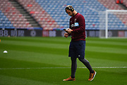 Marko Arnautovic of West Ham United (7) checks his phone on the pitch after arriving at the ground before the Premier League match between Huddersfield Town and West Ham United at the John Smiths Stadium, Huddersfield, England on 10 November 2018.