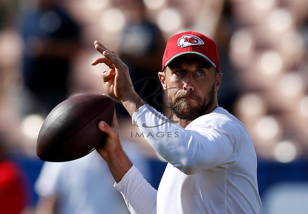 Kansas City Chiefs quarterback Alex Smith warms up prior to a preseason NFL football game against the Los Angeles Rams, Saturday, Aug. 20, 2016, in Los Angeles. (AP Photo/Rick Scuteri)