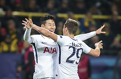November 21, 2017 - Dortmund, Germany - Tottenham Hotspur's South Korean striker Son Heung-Min (L) celebrates scoring with his team-mate Tottenham Hotspur's Harry Winks during the UEFA Champions League Group H football match BVB Borussia Dortmund v Tottenham Hotspur at the BVB Stadion on November 21, 2017 in Dortmund, western Germany. (Credit Image: © Ahmad Mora/NurPhoto via ZUMA Press)