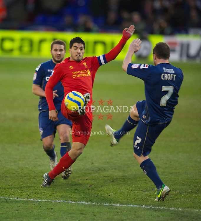 OLDHAM, ENGLAND - Sunday, January 27, 2013: Liverpool's captain Luis Alberto Suarez Diaz in action against Oldham Athletic during the FA Cup 4th Round match at Boundary Park. (Pic by David Rawcliffe/Propaganda)
