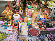 11 MARCH 2013 - LUANG PRABANG, LAOS:  A woman in her market stall in Luang Prabang, Laos.    PHOTO BY JACK KURTZ