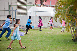 Easter egg hunt on the grounds of Crown Bay.  Easter Sunday Extravaganza at Crown Bay Center.  St. Thomas, VI.  5 April 2015.  © Aisha-Zakiya Boyd