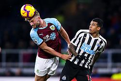 Charlie Taylor of Burnley beats Kenedy of Newcastle United to a header - Mandatory by-line: Robbie Stephenson/JMP - 26/11/2018 - FOOTBALL - Turf Moor - Burnley, England - Burnley v Newcastle United - Premier League
