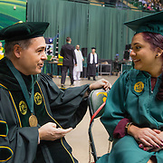 FAIRFAX, VA -DEC21: Emerita Ayala, 23, is congratulated by George Mason University president, Angel Cabrera, before her commencement ceremony at George Mason, December 21, 2016, in Fairfax, Virginia, where she received a bachelor's degree. It's been a long odyssey through college, Emerita started as a teenage mom at 18, with her 3-year-old son at community college. She got help through a nonprofit called Generation Hope that provides scholarships and mentoring to teenage moms. (Photo by Evelyn Hockstein/For The Washington Post)