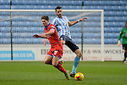 Coventry City defender Aaron Martin tackles Oldham Athletic striker Daniel Philliskirk during the Sky Bet League 1 match between Coventry City and Oldham Athletic at the Ricoh Arena, Coventry, England on 19 December 2015. Photo by Alan Franklin.