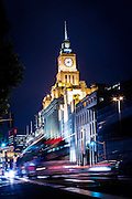 Blur of traffic on the Bund and Customs House in Shanghai, China