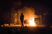 CALAIS, FRANCE - OCT 23: Camp residents set fire to portable toilets in the 'Junlge' in protest to its imminent demolition.