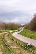 Nederland, Kerkrade , 20040408.<br /> Herdenkingsmonument voor de mijnen. doodlopend spoor langs de Heiweg in Kerkrade. Tiener op een scooter komt aanrijden.