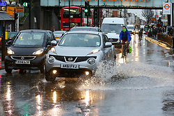 © Licensed to London News Pictures. 15/01/2020. London, UK. Cars drive through a flood on Green Lanes in north London following heavy overnight rainfall. Photo credit: Dinendra Haria/LNP