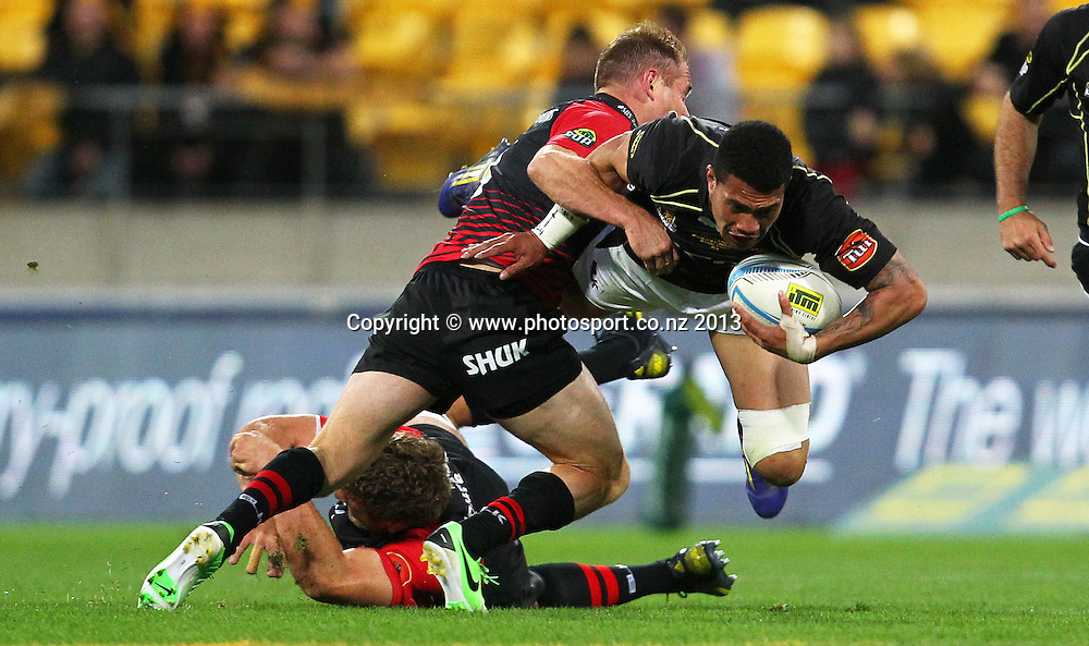 Wellington's Ardie Savea is tackled by Canterbury's Andy Ellis during the 2013 ITM Cup Premiership Final - Wellington v Canterbury, Westpac Stadium, Wellington, New Zealand, Saturday 26 October 2013. Photo: Justin Arthur / photosport.co.nz