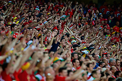 LILLE, FRANCE - Friday, July 1, 2016: Wales supporters  celebrate the first goal against Belgium during the UEFA Euro 2016 Championship Quarter-Final match at the Stade Pierre Mauroy. (Pic by Paul Greenwood/Propaganda)