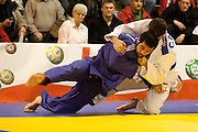 Visé - January 30 : Lyes BOUYAKOUB (blue) from Algeria compete with  Alexandre EDMOND from Canada in the final match of Men's -90 Kg during the Judo Open International 2010 in Visé, Belgium. EDMOND won the match