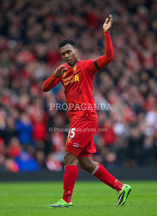 LIVERPOOL, ENGLAND - Saturday, February 8, 2014: Liverpool's Daniel Sturridge salutes the fans as he is substituted against Arsenal during the Premiership match at Anfield. (Pic by David Rawcliffe/Propaganda)