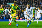 West Bromwich Albion forward Grady Diangana (29) and Leeds United defender Ezgjan Alioski (10) during the EFL Sky Bet Championship match between Leeds United and West Bromwich Albion at Elland Road, Leeds, England on 1 October 2019.