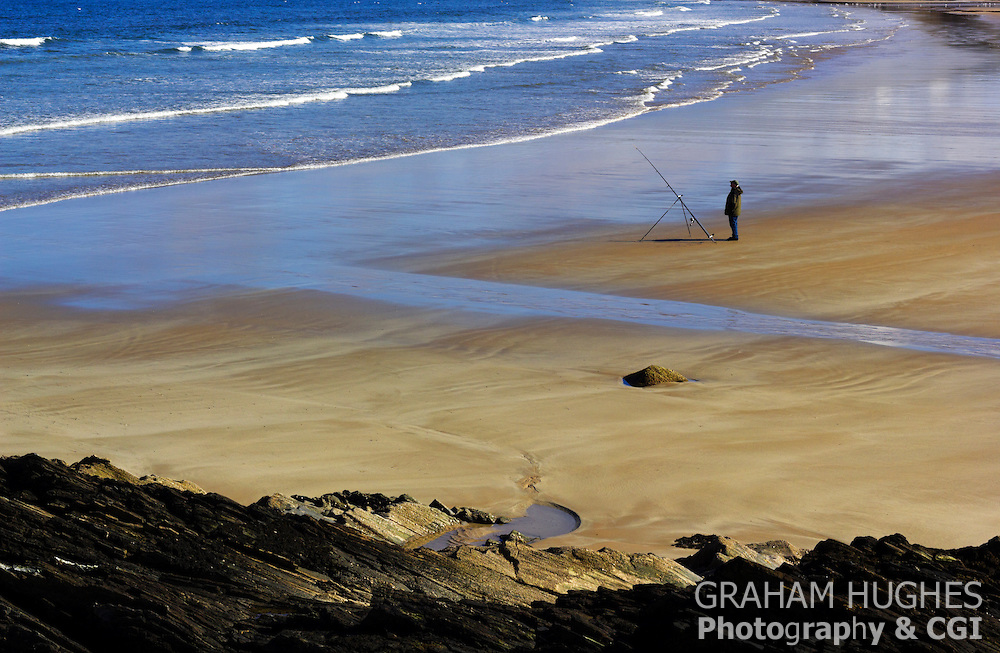 Man Sea Fishing On Beach At Sandend Scotland