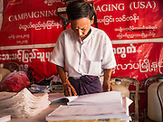 02 NOVEMBER 2015 - YANGON, MYANMAR: A NLD campaign worker reviews lists of voters at a NLD campaign outreach office in Mingaladon, a township in Yangon. Voter registration rolls were released Monday. Voters and party officials are double checking rolls to ensure accuracy.  National elections are scheduled for Sunday Nov. 8. The two principal parties are the National League for Democracy (NLD), the party of democracy icon and Nobel Peace Prize winner Aung San Suu Kyi, and the ruling Union Solidarity and Development Party (USDP), led by incumbent President Thein Sein. There are more than 30 parties campaigning for national and local offices.     PHOTO BY JACK KURTZ