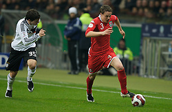 FRANKFURT, GERMANY - Wednesday, November 21, 2007: Wales' Chris Gunter in action against Germany during the final UEFA Euro 2008 Qualifying Group D match at the Commerzbank Arena. (Pic by David Rawcliffe/Propaganda)