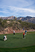 Westin La Paloma Country Club Golf Course. Shots of golfers on fairway and green of hole number one of the Canyon course showing Westin La Paloma Hotel in background. Also, shots of golfers on tee, fairway and green of Canyon hole number four. Golfers are model released...McCain Photography Job #01763.Images created February 16, 1993..Subject photograph(s) are copyrighted by ©1993 Edward McCain / McCain Photography. All rights are reserved except those specifically granted in writing...McCain Photography.211 S 4th Avenue.Tucson, AZ 85701-2103.phone: (520) 623-1998.mobile: (520) 990-0999.fax: (520) 623-1190.http://www.mccainphoto.com.edward@mccainphoto.com