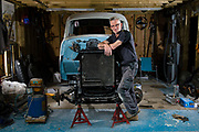 Sudbury, Suffolk. Russell Lydford who has restored a 1946 Chevrolet truck and has a 1954 Chevrolet panel truck in bits that he is going to make his works van.<br /> <br /> Picture: MARK BULLIMORE
