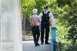 © Licensed to London News Pictures. 12/07/2018. London, UK. A police officer talks to a resident at a closed off section of Regent's Park surrounding the US Ambassador's residence where US President Trump will stay later.  Photo credit: Peter Macdiarmid/LNP