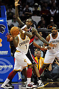 March 27, 2011; Cleveland, OH, USA; Cleveland Cavaliers point guard Daniel Gibson (1) looks for a pass under pressure from Atlanta Hawks guard Jamal Crawford (11) during the third quarter at Quicken Loans Arena. The Hawks beat the Cavaliers 99-83. Mandatory Credit: Jason Miller-US PRESSWIRE