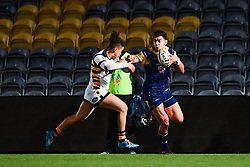 Bryce Heem of Worcester Cavaliers fends off Jacob Umaga of Wasps - Mandatory by-line: Craig Thomas/JMP - 23/10/2017 - RUGBY - Sixways Stadium - Worcester, England - Worcester Cavaliers v Wasps - Aviva A League