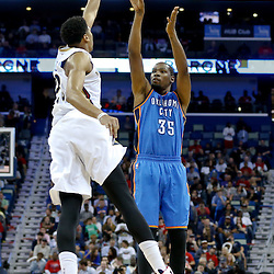 Dec 2, 2014; New Orleans, LA, USA; Oklahoma City Thunder forward Kevin Durant (35) shoots over New Orleans Pelicans forward Anthony Davis (23) during the second half of a game at the Smoothie King Center. The Pelicans defeated the Thunder 112-104. Mandatory Credit: Derick E. Hingle-USA TODAY Sports