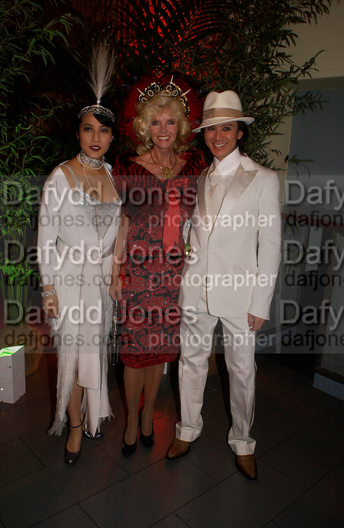 Patti Wong, Countess Gunilla von Bismarck and Andy Wong.  Andy & Patti Wong's Chinese New Year party to celebrate the year of the Rooster held at the Great Eastern Hotel, Liverpool Street, London.29th January 2005. The theme was a night of hedonism in 1920's Shanghai. . ONE TIME USE ONLY - DO NOT ARCHIVE  © Copyright Photograph by Dafydd Jones 66 Stockwell Park Rd. London SW9 0DA Tel 020 7733 0108 www.dafjones.com