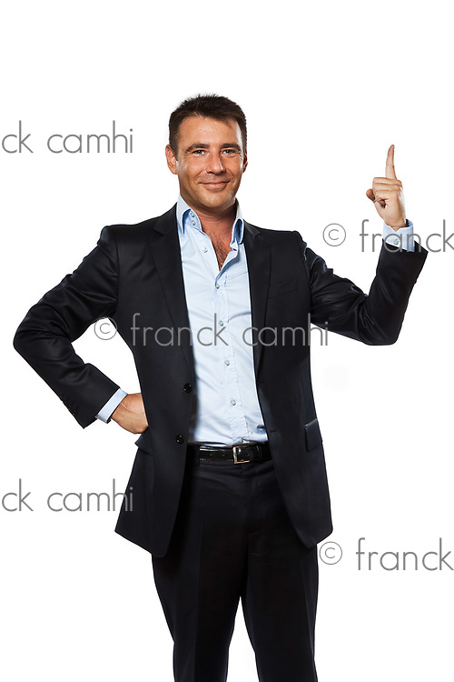 one caucasian business man pointing up finger blank copy space in studio isolated on white background
