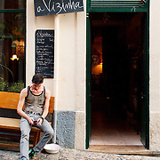 Customer smoking outside one of  Bica's trendy cafes