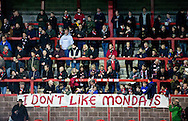 FC United of Manchester supporters put up a flag of protest over the FA's decision to move the fixture to a Monday night, before the FA Cup match at Broadhurst Park, Moston<br /> Picture by Russell Hart/Focus Images Ltd 07791 688 420<br /> 09/11/2015