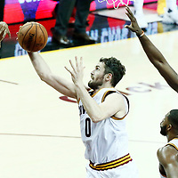 09 June 2017: Cleveland Cavaliers forward Kevin Love (0) vies for the rebound with Golden State Warriors forward Andre Iguodala (9) during the Cleveland Cavaliers 137-11 victory over the Golden State Warriors, in game 4 of the 2017 NBA Finals, at  the Quicken Loans Arena, Cleveland, Ohio, USA.