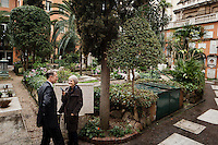 VATICAN CITY - 13 MARCH 2013: (L-R) Dr. Hans-Peter Fischer, rector of Collegio Teutonico, is interviewed by journalist Barbara Baumgartner, at the cemetery of the Collegio Teutonico, in Vatican City, on March 13, 2013. The Collegio Teutonico is the German College, the oldest German foundation in Rome, that was established and maintained at the Vatican for the education of future ecclesiastics of the Roman Catholic Church of German nationality. The college continues to assist poor Germans who come to Rome, either to visit the holy places or in search of occupation...On March 12, 2013, the 115 cardinals entered the conclave to elect a successor to Pope Benedict XVI after he became the first pope in 600 years to resign from the role. The conclave will take place inside the Sistine Chapel and will be attended by 115 cardinals as they vote to select the 266th Pope of the Catholic Church.