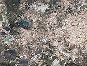 IN FLIGHT- AUGUST 30: A neighborhood near Waveland, MS is left in rubble Tuesday, August 30, 2005. Over 100 people are feared dead and estimates put the property loss at nearly $30 billion as Hurricane Katrina could become the costliest storm in US history.<br />