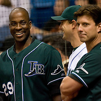 Former Tampa Bay Devil Rays players Fred McGriff (L) and Tino Martinez (R) share a laugh with current Devil Rays player Doug Waechter (C) before the start of the Devil Rays game against the Baltimore Orioles at Tropicana Field in St. Petersburg, Florida on April 10, 2006. REUTERS/Scott Audette