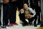 Jeremiah Jefferson (15) of Dallas Triple A Academy celebrates with his championship medal and tournament MVP plaque after defeating Mumford in the UIL 1A division 1 state championship game at the Frank Erwin Center in Austin on Saturday, March 9, 2013. (Cooper Neill/The Dallas Morning News)