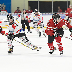 WHITBY, - Dec 13, 2015 -  WJAC Game 2- Team Switzerland vs Team Canada East at the 2015 World Junior A Challenge at the Iroquois Park Recreation Complex, ON. Yannick Lerch #18 of Team Switzerland and Josh Dickinson #15 of Team Canada East pursue the play during the first period.<br /> (Photo: Andy Corneau / OJHL Images)