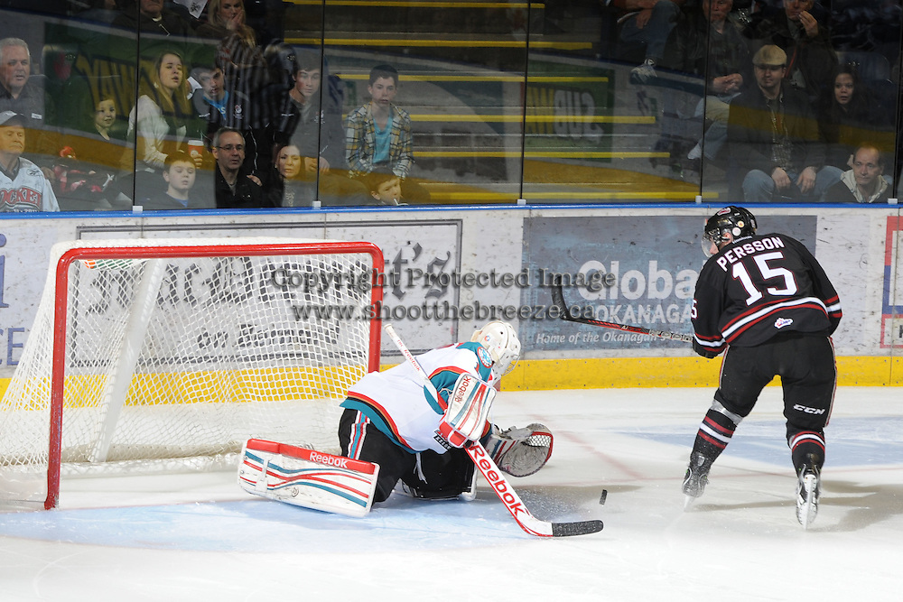 KELOWNA, CANADA - FEBRUARY 18: Adam Brown #1 of the Kelowna Rockets makes a save against John Perrson #15 of the Red Deer Rebels during the shoot out at the Kelowna Rockets on February 18, 2012 at Prospera Place in Kelowna, British Columbia, Canada (Photo by Marissa Baecker/Shoot the Breeze) *** Local Caption ***