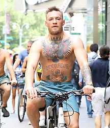 EXCLUSIVE: Conor McGregor seen shirtless while riding his bike in NYC. 18 Jun 2018 Pictured: Conor McGregor. Photo credit: ZapatA/MEGA TheMegaAgency.com +1 888 505 6342