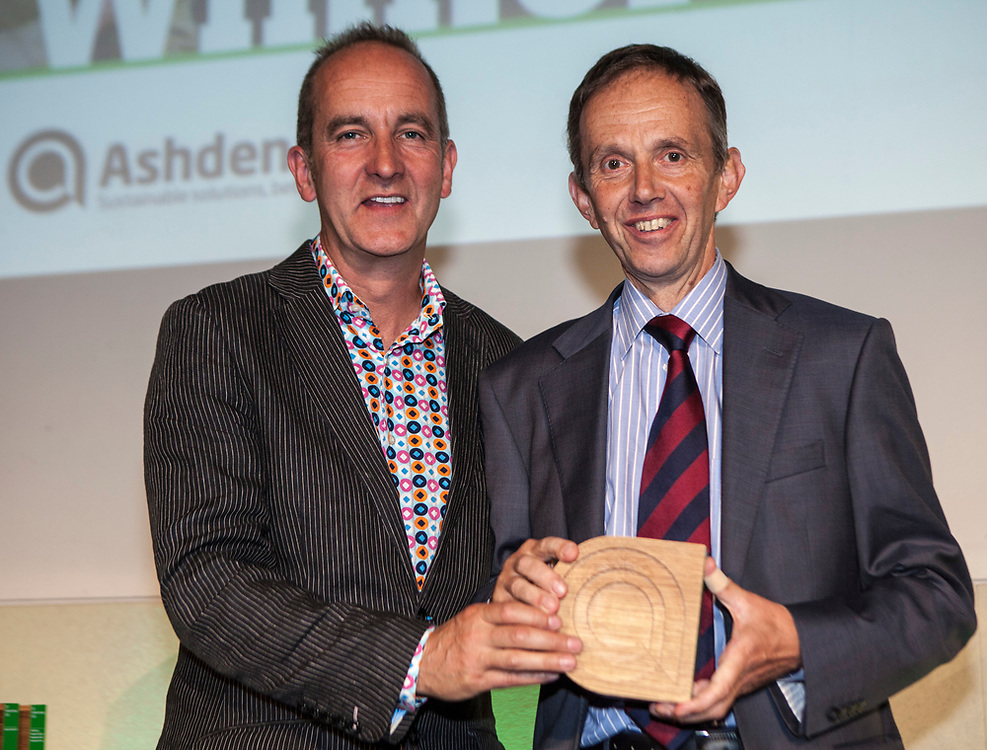 Kevin McCloud, author, broadcaster and designer presenting  Andrew King of Energy 4 All with an Ashden award. The 2012 Ashden Awards for sustainable energy ceremony at the Royal Geographical Society. London.