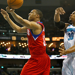 January 3, 2011; New Orleans, LA, USA; New Orleans Hornets power forward David West (30) knocks the ball away from Philadelphia 76ers shooting guard Evan Turner (12) during the second quarter at the New Orleans Arena.   Mandatory Credit: Derick E. Hingle