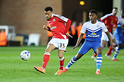 Crewe Alexandra's Nicky Ajose in action with Peterborough United's Kgosi Ntlhe - Photo mandatory by-line: Joe Dent/JMP - Mobile: 07966 386802 - 14/04/2015 - SPORT - Football - Peterborough - ABAX Stadium - Peterborough United v Crewe Alexandra - Sky Bet League One
