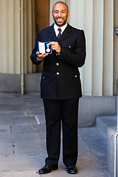 BTP Constable Leon McLeod displays his Queens Gallantry Medal following an investiture by Her Majesty The Queen at Buckingham Palace in London. London, October 11 2018.
