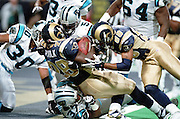 Running Back Marshall Faulk (28) of the St. Louis Rams gets helped into the end zone by teammate wide receiver Torry Holt (88) against the Carolina Panthers in a 48 to 14 win by the Rams on 11/11/2001..©Wesley Hitt/NFL Photos