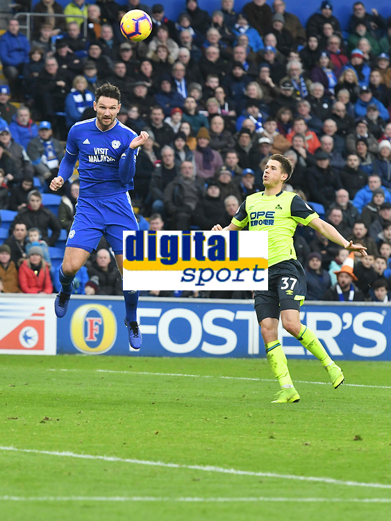 Football - 2018 / 2019 Premier League - Cardiff City vs. Huddersfield Town<br /> <br /> Sean Morrison Cardiff City leaps to head the ball challenged by \37\, at the Cardiff City Stadium.<br /> <br /> COLORSPORT/WINSTON BYNORTH